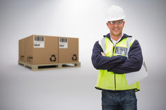 Composite image of worker wearing hard hat in warehouse Royalty Free Stock Photos