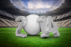 Composite image of world cup 2014 in white and grey. World cup 2014 in white and grey against vast football stadium with fans in white Royalty Free Stock Image