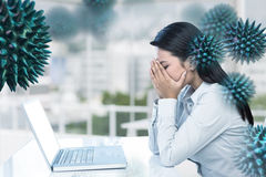 Composite image of worried businesswoman covering face. Worried businesswoman covering face against office royalty free stock images