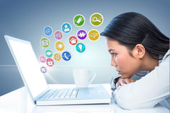Composite image of worried businesswoman in front of her laptop Stock Photos