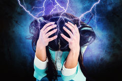 Composite image of worried businesswoman holding her head Royalty Free Stock Photography