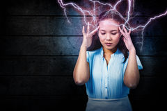 Composite image of worried businesswoman holding her head Stock Photos