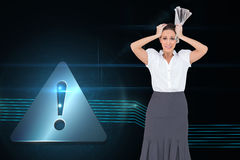 Composite image of worried businesswoman holding newspaper Stock Images