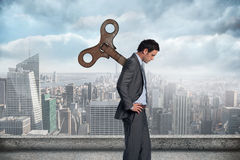 Composite image of wound up businessman with hands on hips Stock Photography