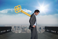 Composite image of wound up businessman with hands on hips Royalty Free Stock Photos
