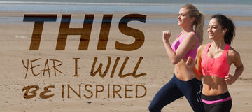 Composite image of this year i will be inspired. This year i will be inspired against full length of healthy women jogging on beach Royalty Free Stock Images