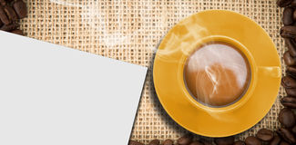 Composite image of yellow cup of coffee Royalty Free Stock Photography