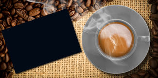 Composite image of yellow cup of coffee Stock Images