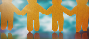 Composite image of 4 yellow paper person holding hands Royalty Free Stock Images