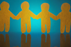 Composite image of 4 yellow paper person holding hands Royalty Free Stock Photos