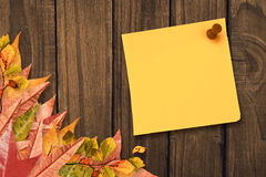 Composite image of yellow pinned adhesive note Royalty Free Stock Image