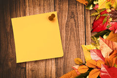 Composite image of yellow pinned adhesive note Royalty Free Stock Photo