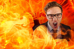 Composite image of young angry businessman shouting at camera Royalty Free Stock Photography