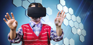 Composite image of young boy in red jumper with virtual reality headset royalty free stock photo