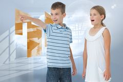 Composite image of young boy showing something to his sister Stock Photo