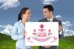 Composite image of young business partners presenting sign Royalty Free Stock Photography