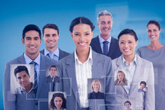 Composite image of young business people in office stock photo