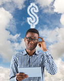 Composite image of young businessman thinking and holding tablet Royalty Free Stock Photo