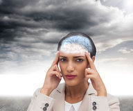 Composite image of young businesswoman putting her fingers on her temples Stock Photography