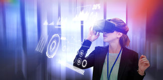 Composite image of young businesswoman using virtual reality glasses. Young businesswoman using virtual reality glasses against modern empty meeting room stock photography