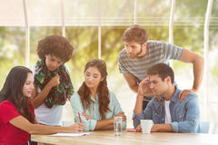 Composite image of young colleagues in discussion at office Royalty Free Stock Image