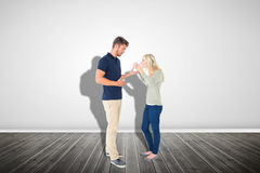 Composite image of young couple having an argument Stock Photography