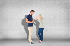 Composite image of young couple having an argument Stock Photos