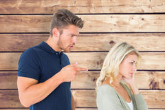 Composite image of young couple having an argument Royalty Free Stock Photo