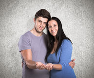 Composite image of young couple holding out hands Stock Image