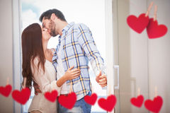 Composite image of young couple kiss as they open front door Royalty Free Stock Photography