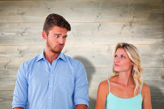Composite image of young couple making silly faces Royalty Free Stock Photography