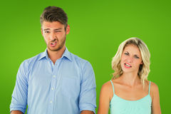 Composite image of young couple making silly faces Stock Photos