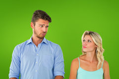 Composite image of young couple making silly faces Royalty Free Stock Images