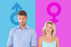Composite image of young couple making silly faces Royalty Free Stock Image