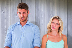 Composite image of young couple making silly faces Stock Photography