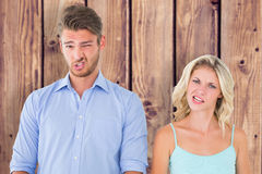 Composite image of young couple making silly faces Stock Image