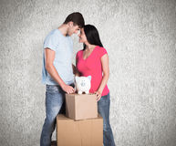 Composite image of young couple with moving boxes Royalty Free Stock Photo