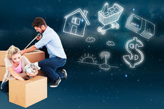 Composite image of young couple packing moving boxes Royalty Free Stock Photo