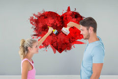 Composite image of young couple painting with brushes Stock Photo