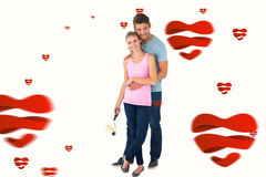 Composite image of young couple painting with roller. Young couple painting with roller against hearts stock photography