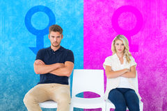 Composite image of young couple sitting in chairs not talking during argument Stock Image