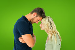 Composite image of young couple standing head to head Stock Image