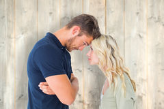 Composite image of young couple standing head to head Royalty Free Stock Image