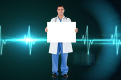 Composite image of young doctor showing card Royalty Free Stock Photography