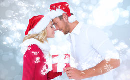 Composite image of young festive couple Stock Images