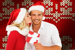 Composite image of young festive couple stock photo