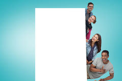 Composite image of young friends showing card. Young friends showing card against blue vignette Royalty Free Stock Photo