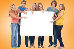Composite image of young friends showing card Stock Photography
