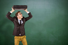 Composite image of young geeky businessman holding briefcase Royalty Free Stock Photography