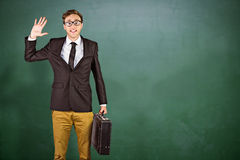 Composite image of young geeky businessman holding briefcase Stock Images